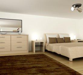 Sypialnia z ozdobnym dywanem